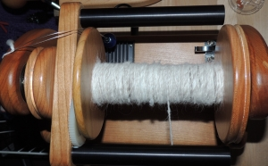 The Minispinner is cherry, as is the bobbin.  I splurged on a bloodwood bobbin for my plying bobbin.