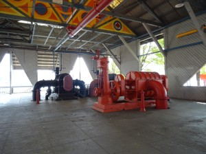 """Inside the barn of the Gas Works; this is called a """"children's play barn"""" and all the machinery has been brightly painted, although children (and adults) are forbidden to climb on it."""