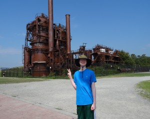 Alex in front of the gas plant structure that remains.